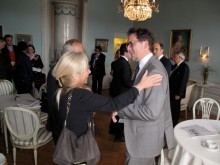 Pia Hellman greets Open's David Gray during Cavotec's AGM in Stockholm