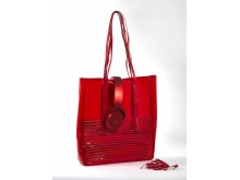 sony h.ear on red headphones with beach bag