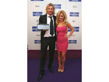 Robbie Savage wins Sony DAB Rising Star Award presented by Geri Halliwell - credit Jab Promotions