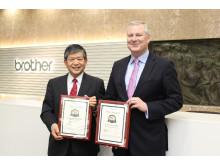 Brother Industries Ltd President Ichiro Sasaki receives the BLI Winter 2019 Pick Awards from BLI's Gerry O'Rourke