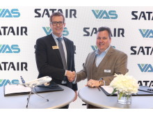 Nicolai Hertz, Head of Servicable Parts, Satair (left) shakes hands with Tommy Hughes, Chief Executive Officer, VAS Aero Services
