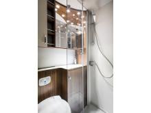 Badrum med integrerad dusch