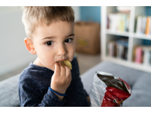 Child eating unhealthy snacks.jpg