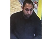 CCTV image of a man officers would like to speak to in relation to a fraud in Milton Keynes