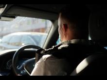Officers on car patrol.JPG