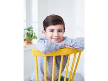 Junge trägt Cochlear Baha® SoundArc