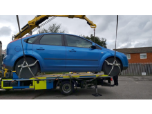 A seized car being removed