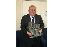Alan Seldon with fist from statue