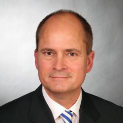 Dr. Falko Milski