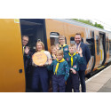 Astwood Bank Scouts celebrate Cross City Heroes win at Redditch station