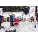 Female mechanic in garage car -939152828.jpg