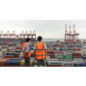 Panalpina employees looking down on containers in the port of Shanghai, China.