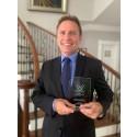 Arnt-Helge Olsen, VP Subsea Sales, receives the prize on behalf on Kongsberg Maritime